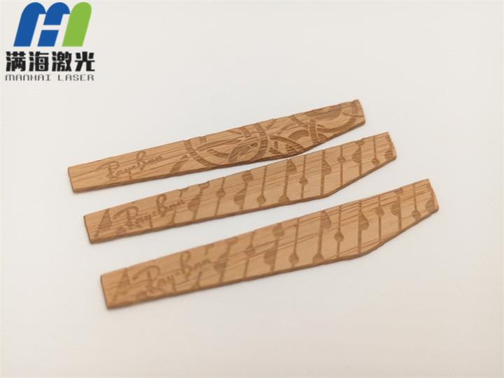 眼镜镜脚木制贴片激光雕刻加工